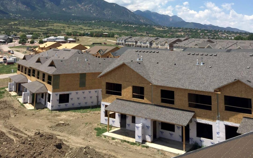 under construction houses with grey roofs
