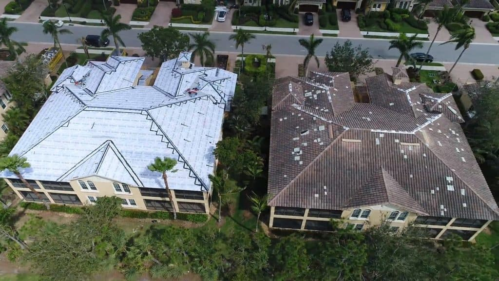 Roofs being repaired after experiencing wind damage in Naples, Florida
