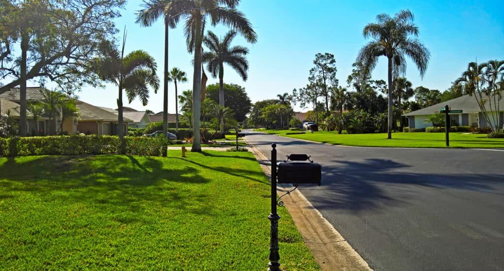 Sunny residential street in Naples Florida