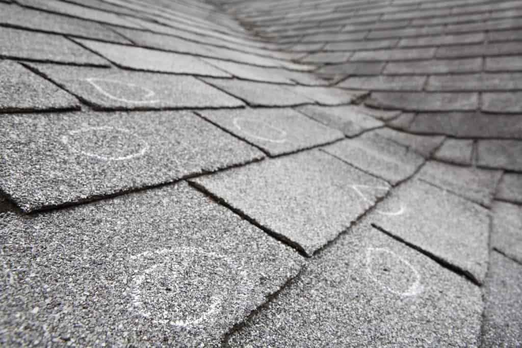 Old roof with chalk circling hail damage