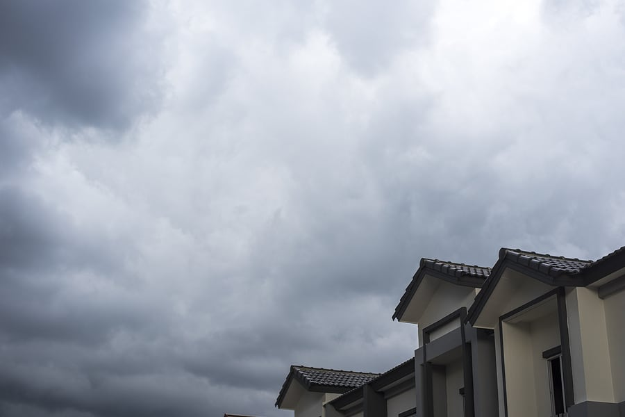 spanish tile roof with stormy cloud background
